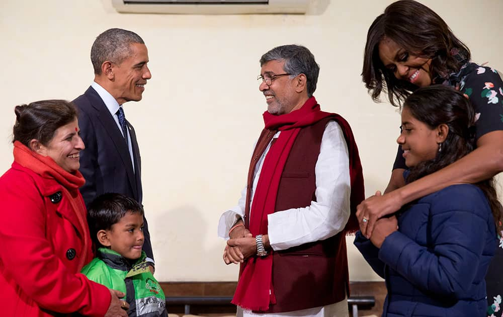 President Barack Obama and first lady Michelle Obama meet with Kailash Satyarthi, third from right, his wife Sumedha Satyarth, left, with Deepak, and Payal Jangid, right, at the Siri Fort Auditorium in New Delhi.
