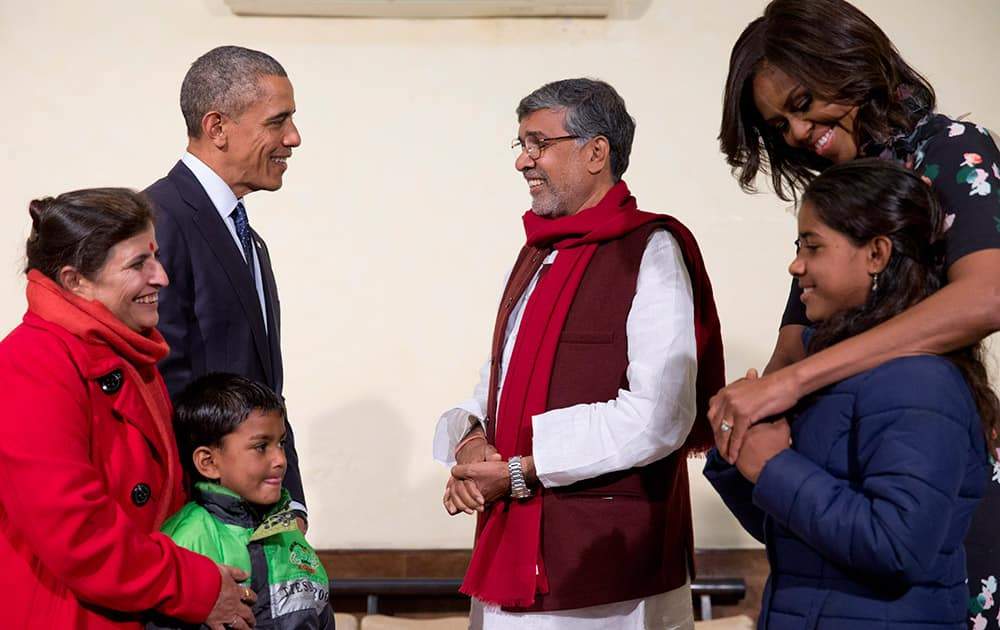 U.S. President Barack Obama and first lady Michelle Obama meet with Kailash Satyarthi, his wife Sumedha Satyarth, with Deepak, and Payal Jangid, at the Siri Fort Auditorium in New Delhi.