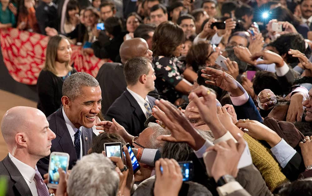 President Barack Obama greets people in the audience after his speech at the Siri Fort Auditorium in New Delhi.