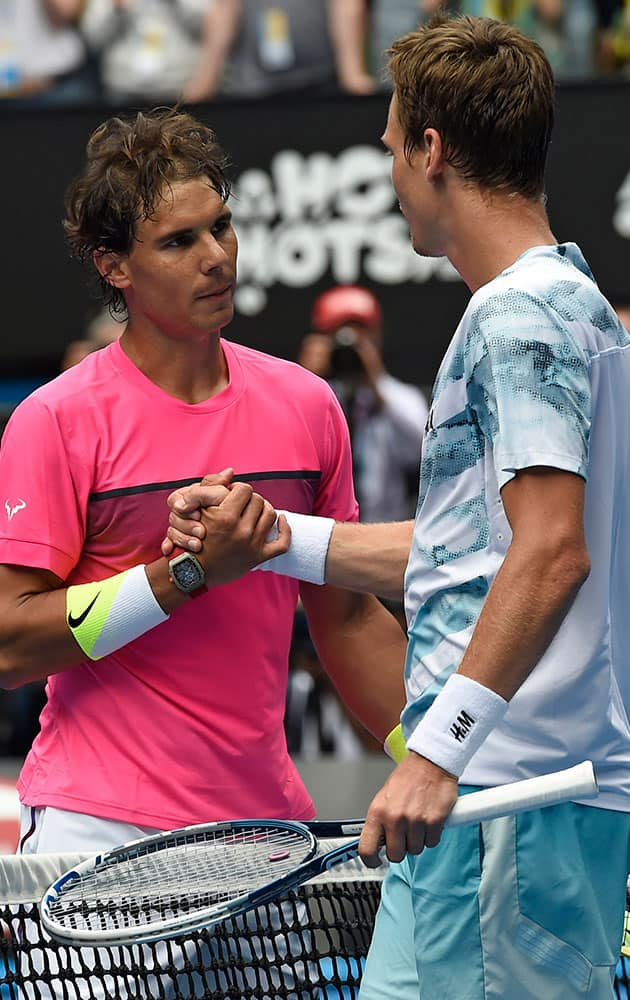 Tomas Berdych of the Czech Republic, right, is congratulated by Rafael Nadal of Spain at the net after winning during their quarterfinal match at the Australian Open tennis championship in Melbourne, Australia.