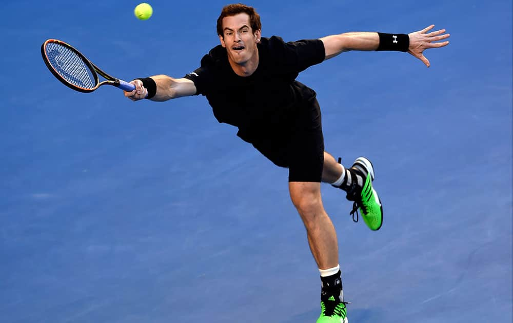 Andy Murray of Britain reaches out for a shot to Nick Kyrgios of Australia during their quarterfinal match at the Australian Open tennis championship in Melbourne, Australia.
