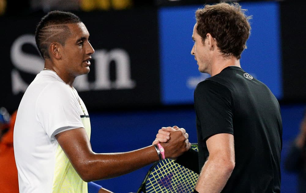 Andy Murray of Britain, right, is congratulated by Nick Kyrgios of Australia after winning their quarterfinal match at the Australian Open tennis championship in Melbourne, Australia.