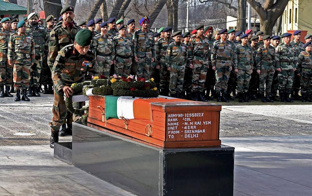 15 corps Commander Subrata Saha laying a wreath on the coffin of Col MN Rai at Badami Bagh headquarters in Srinagar.
