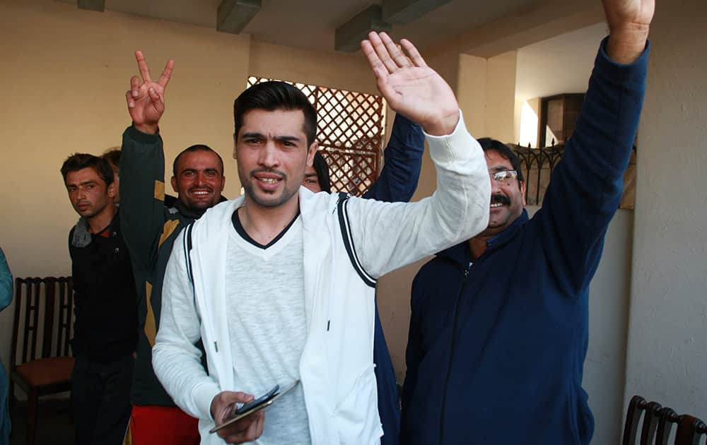 Pakistan fast bowler Mohammad Amir waves after a press conference in Lahore, Pakistan. The International Cricket Council allowed Amir to play in Pakistan's domestic cricket, easing out fast bowler's five-year ban which ends in September.