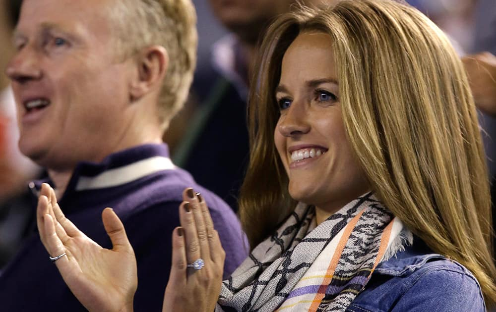 Kim Sears, fiancee of Andy Murray of Britain applauds after Murray's semifinal win over Tomas Berdych of the Czech Republich at the Australian Open tennis championship in Melbourne, Australia.