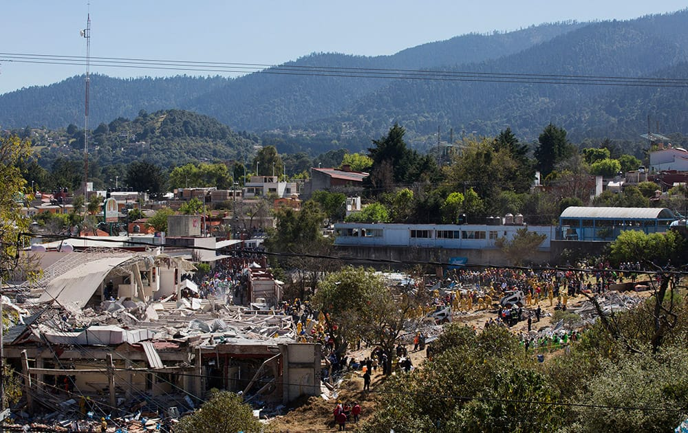 Rescue workers search for survivors in the rubble of a maternity and children's hospital that was shattered by a gas tank truck explosion, in Cuajimalpa on the outskirts of Mexico City
