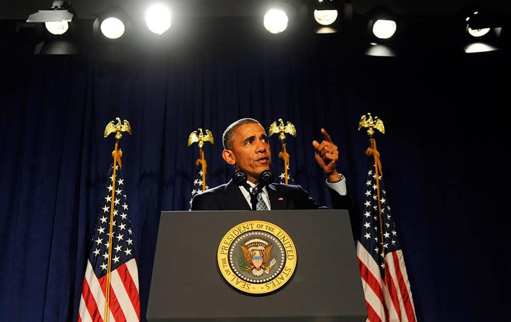 President Barack Obama addresses House Democrats, in Philadelphia.