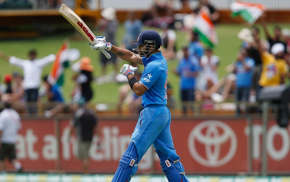 Virat Kohli walks to the crease during their one-day international cricket match against England in Perth.