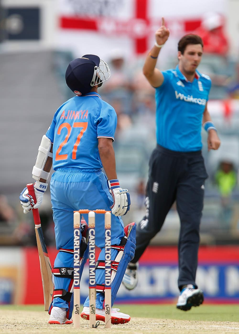 Ajinkya Rahane reacts after being caught behind for 73 runs off the bowling of England's Steven Finn during their one day international cricket match in Perth, Australia.