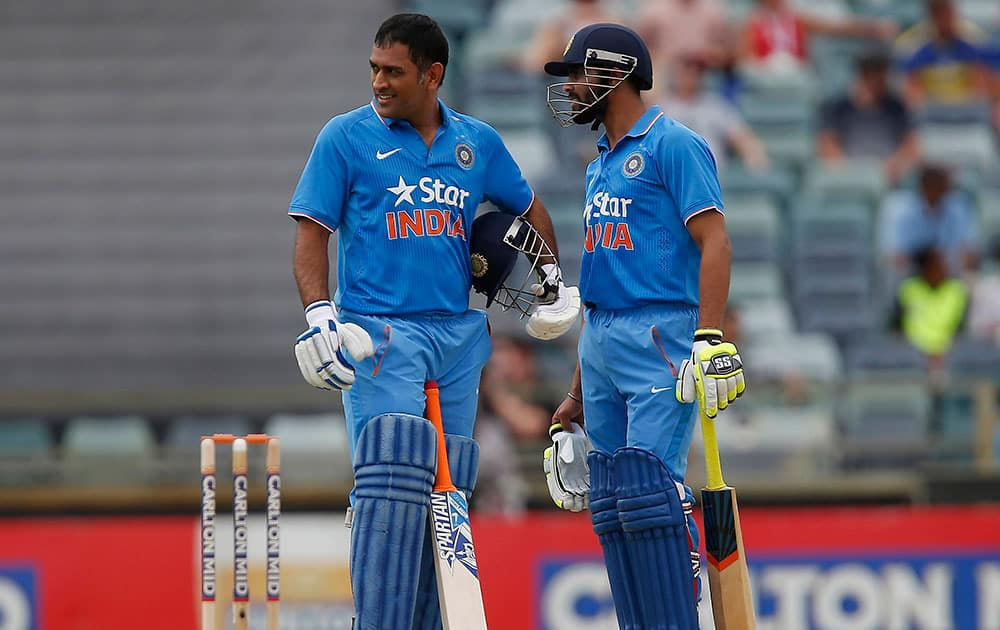 MS Dhoni and team mate Ravindra Jadeja speak during their one-day international cricket match against England in Perth.