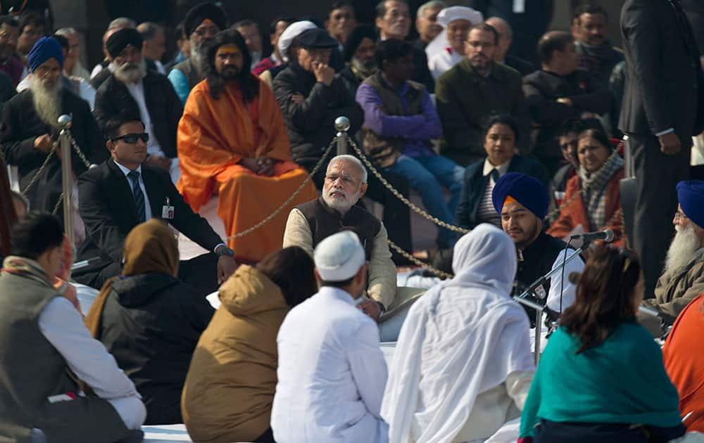 Prime Minister Narendra Modi sits at Rajghat, a memorial to Mahatma Gandhi, on his death anniversary in New Delhi.