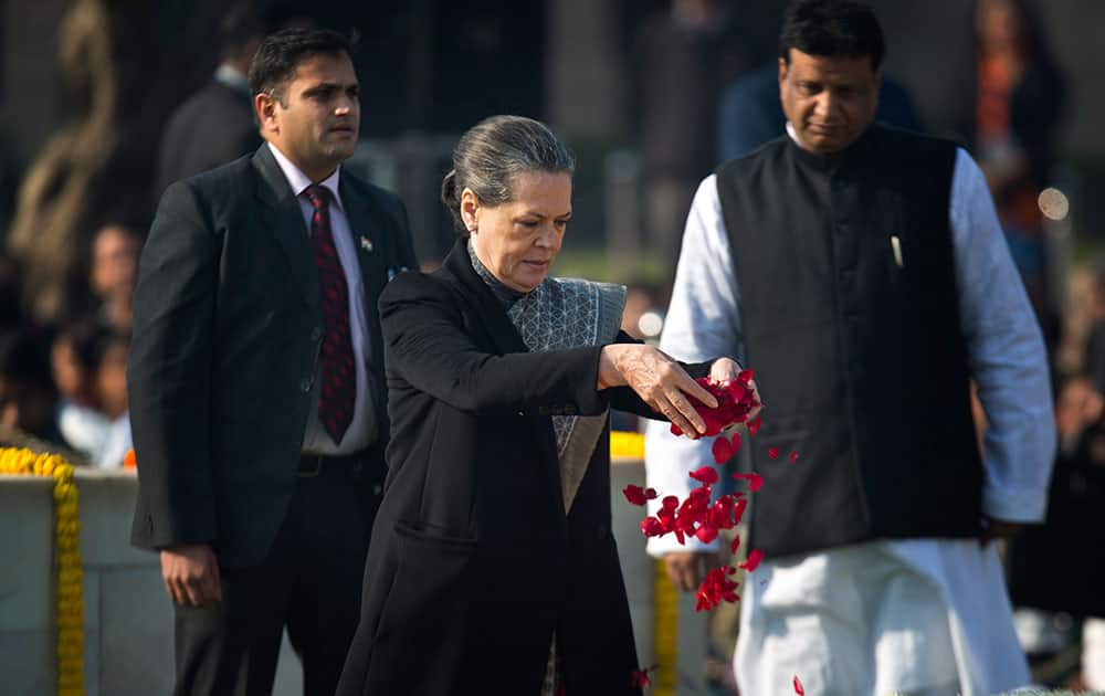 Congress party President Sonia Gandhi offers floral tributes at Rajghat, a memorial to Mahatma Gandhi, on his death anniversary in New Delhi.