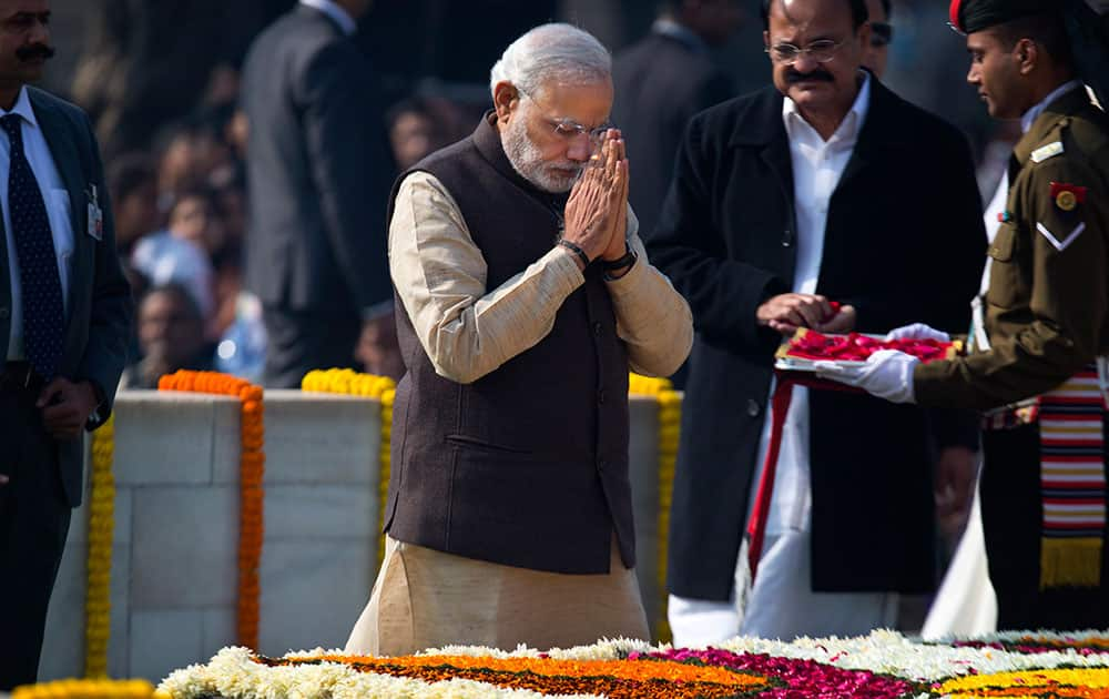 Prime Minister Narendra Modi pays his respect at Rajghat, a memorial to Mahatma Gandhi, on his death anniversary in New Delhi.