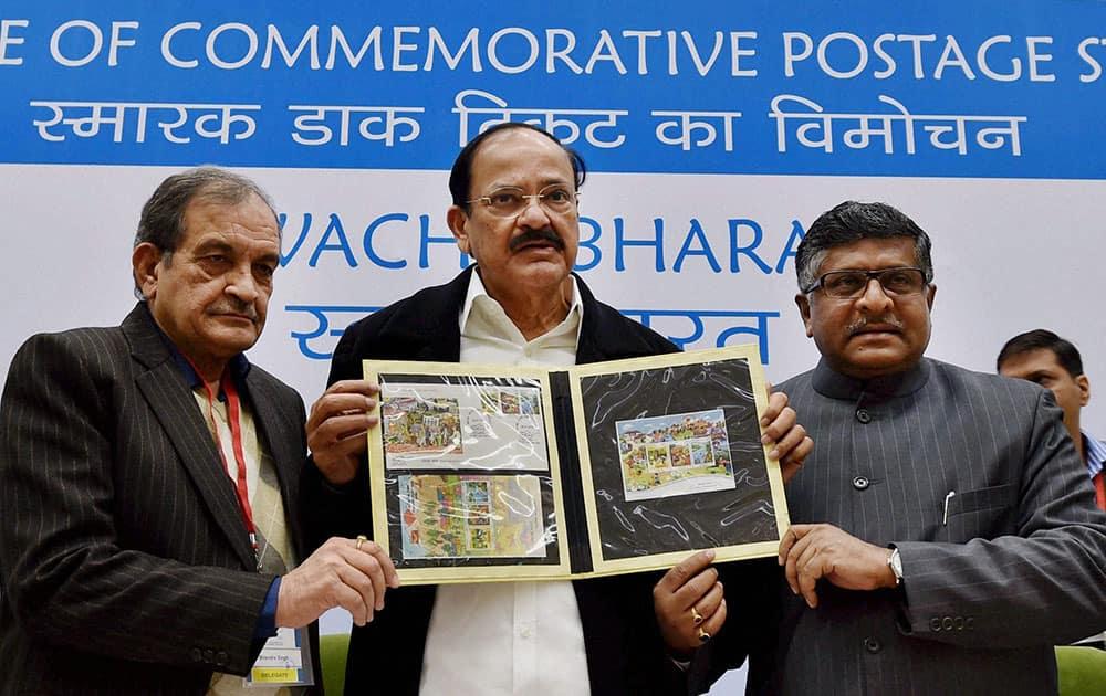 Union Urban Development Minister M Venkaiah Naidu, Minister for Communications and IT, Ravi Shankar Prashad and Minister of Drinking Water & Sanitation Birendra Singh release Postal Stamp on 'Swachh Bharat' campaign in New Delhi.