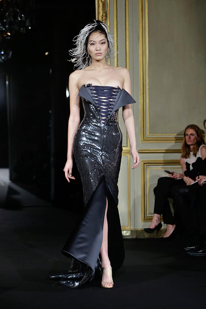 A model wears a creation by French designer Alexis Mabille as part of his Spring-Summer 2015 Haute Couture fashion collection, presented in Paris.