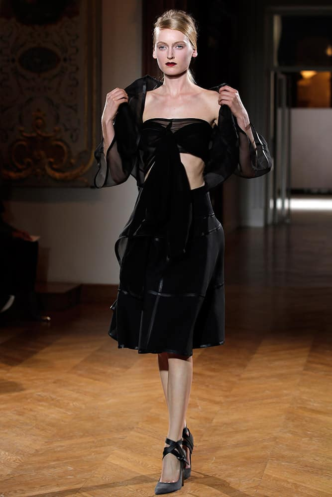A model wears a creation by designer Gustavo Lins for fashion house Atelier Gustavolins during their Spring-Summer 2015 Haute Couture fashion collection, presented in Paris.