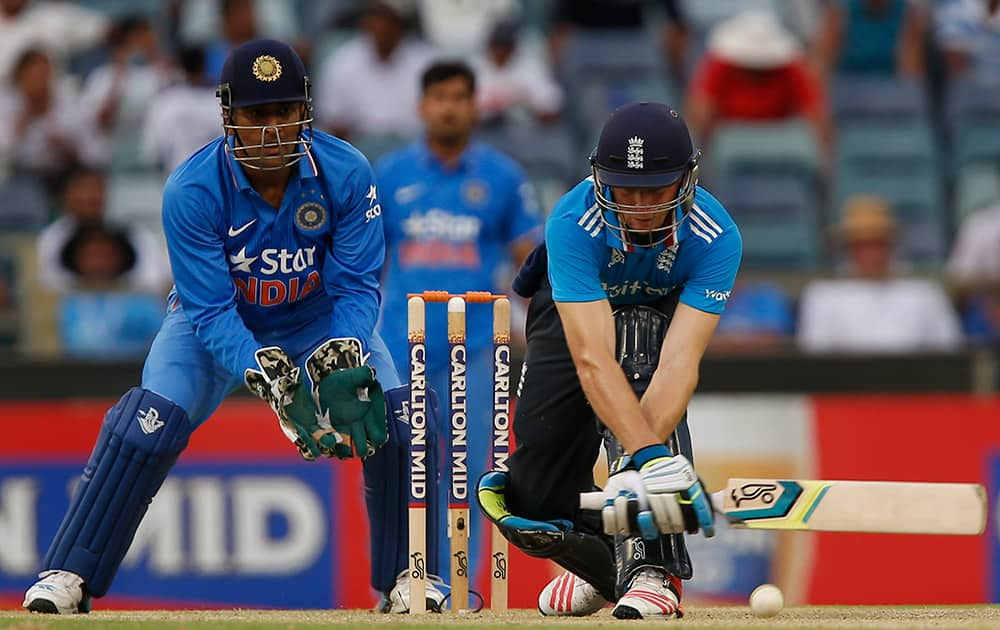 Jos Butler plays a stroke during England's one day international cricket match against India in Perth, Australia.