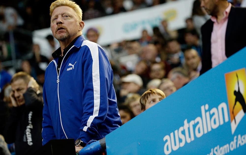 Boris Becker, coach of Novak Djokovic of Serbia watches the semifinal against Stan Wawrinka of Switzerland at the Australian Open tennis championship in Melbourne, Australia.