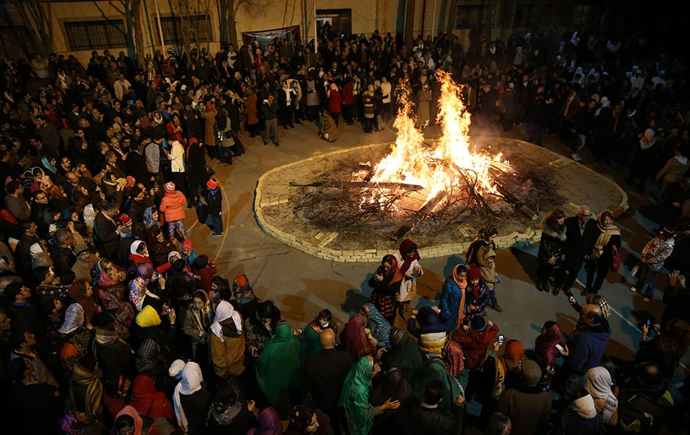 Iranian Zoroastrians gather around a giant bonfire in a ceremony celebrating their ancient mid-winter Sadeh festival in Tehran, Iran.