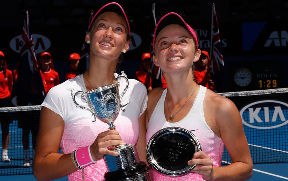 Tereza Mihalikova of Slovakia, holds the trophy with runner-up Katie Swan of Britain after winning the junior girls' singles final at the Australian Open tennis championship in Melbourne, Australia.