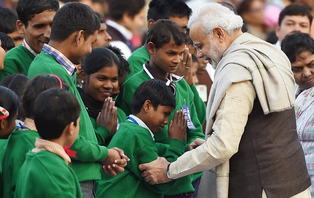 Prime Minister Narendra Modi meeting visually challenged children on the occasion of Mahatma Gandhis death anniversary, at Gandhi Smriti in New Delhi .