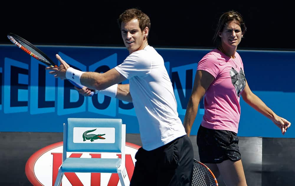 Andy Murray of Britain practices as his coach Amelie Mauresmo looks on ahead of the men's singles final at the Australian Open tennis championship in Melbourne, Australia. Murray will play Novak Djokovic of Serbia in Sunday's final.