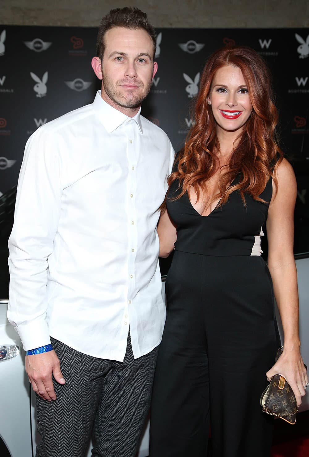 Evan Longoria and Jaime Edmondson arrive at the Playboy Super Bowl XLIX Party in Scottsdale, Ariz.