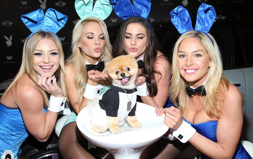 Jiff with Playboy Playmates arrives at the Playboy Super Bowl XLIX Party in Scottsdale, Ariz.