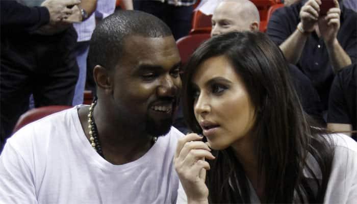 Kim, Kanye pose with President Obama