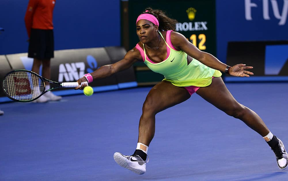Serena Williams of the stretches out for a return to US Maria Sharapova of Russia during the women's singles final at the Australian Open tennis championship in Melbourne, Australia.