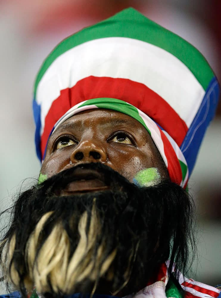 An Equatorial Guinea soccer fan watches during the African Cup of Nations quarter final soccer match between Equatorial Guinea and Tunisia in Bata, Equatorial Guinea.