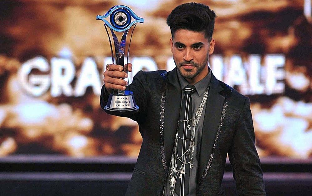 TV actor Gautam Gulati took the Bigg Boss trophy and Rs.50 lakh cash prize after winning the season 8 of celebrity reality show Bigg Boss in Lonavala, Maharashtra.