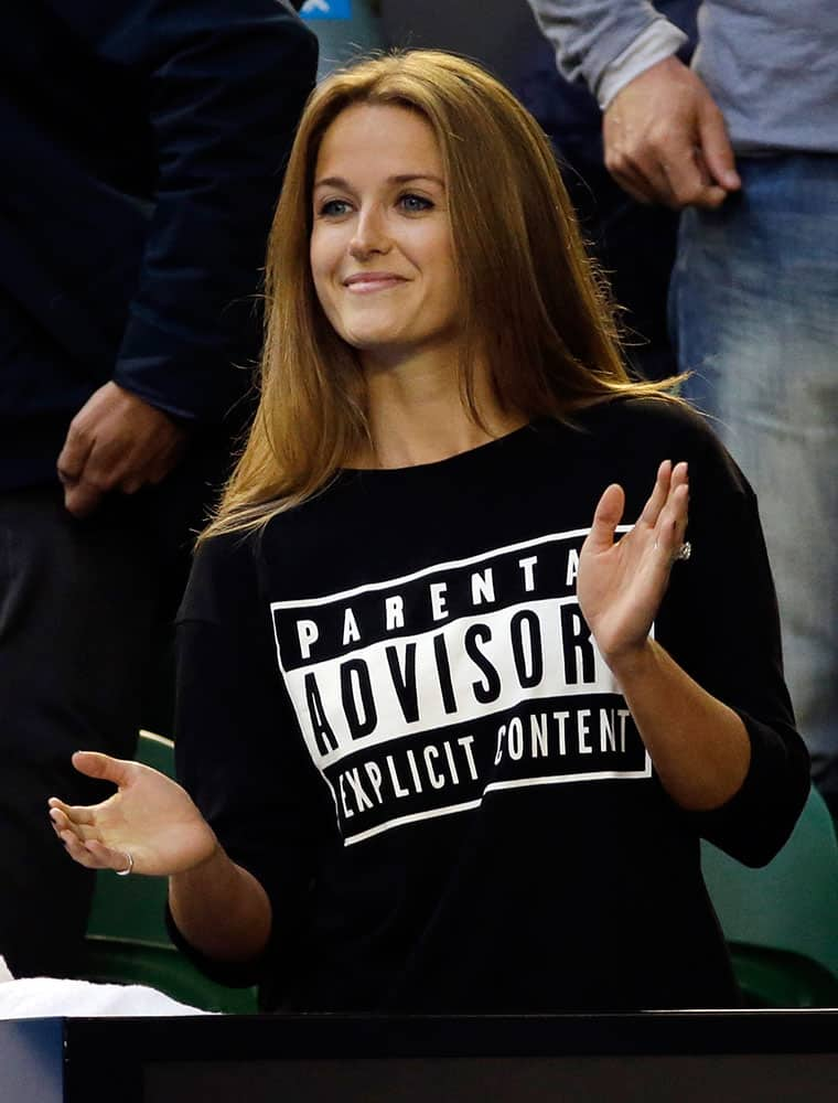 Kim Sears, fiancee of Andy Murray of Britain, applauds before his men's singles final against Novak Djokovic of Serbia during the men's singles final at the Australian Open tennis championship.