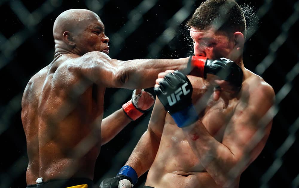 Middleweight Anderson Silva draws a fist across the face of Nick Diaz during their fight at the MGM Grand Garden Arena in Las Vegas.