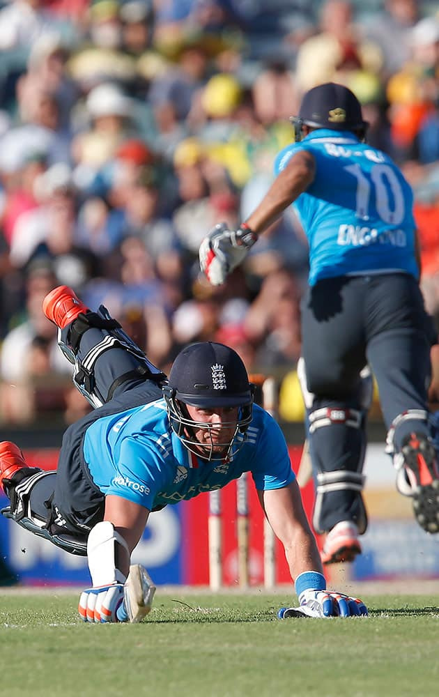 England's Stuart Broad, left, dives to make his crease during their one day international cricket match against Australia in Perth, Australia.
