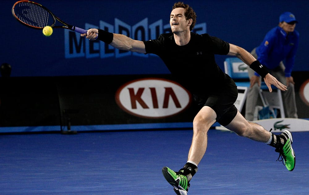 Andy Murray of Britain chases down a shot to Novak Djokovic of Serbia during the men's singles final at the Australian Open tennis championship in Melbourne, Australia, Sunday.