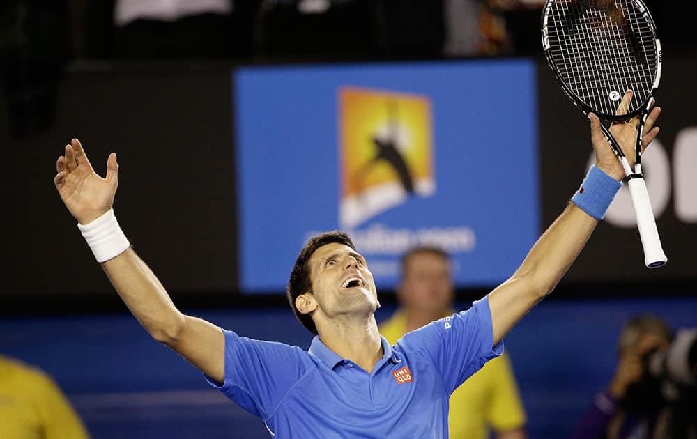 Novak Djokovic of Serbia celebrates after defeating Andy Murray of Britain in the men's singles final at the Australian Open tennis championship in Melbourne, Australia, Sunday.