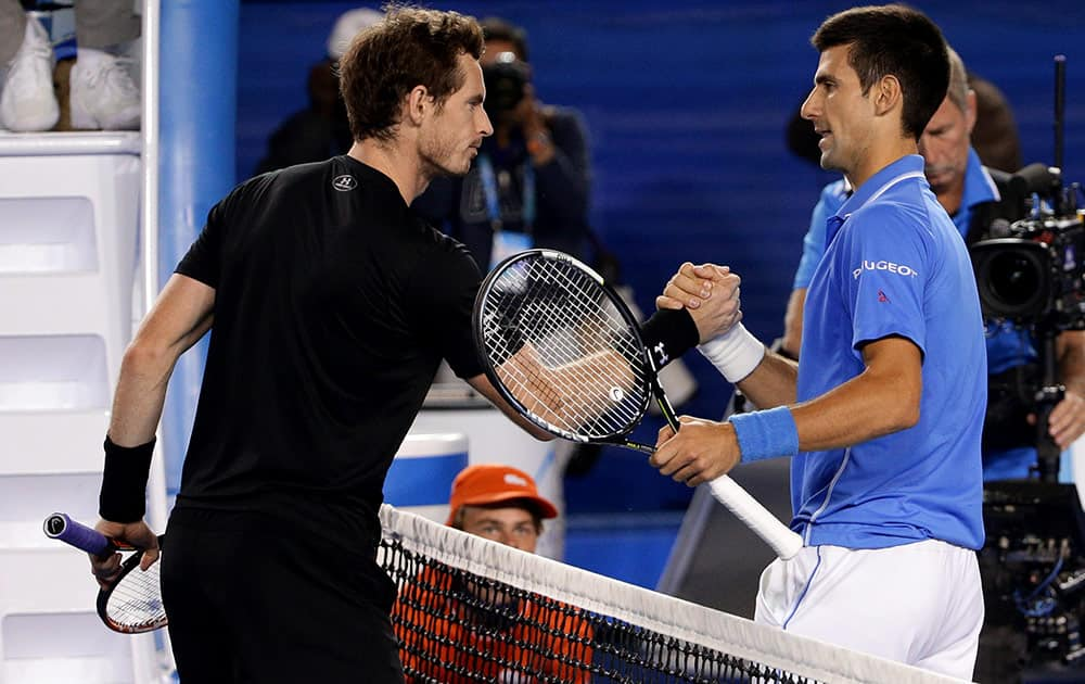 Novak Djokovic of Serbia, right, is congratulated by Andy Murray of Britain after winning the men's singles final at the Australian Open tennis championship in Melbourne, Australia.