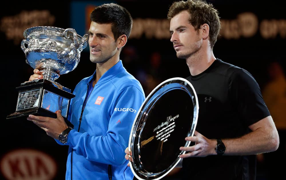 Novak Djokovic of Serbia, left, holds the trophy with runner-up Andy Murray of Britain during the trophy presentation after winning their men's singles final at the Australian Open tennis championship in Melbourne, Australia, Sunday.