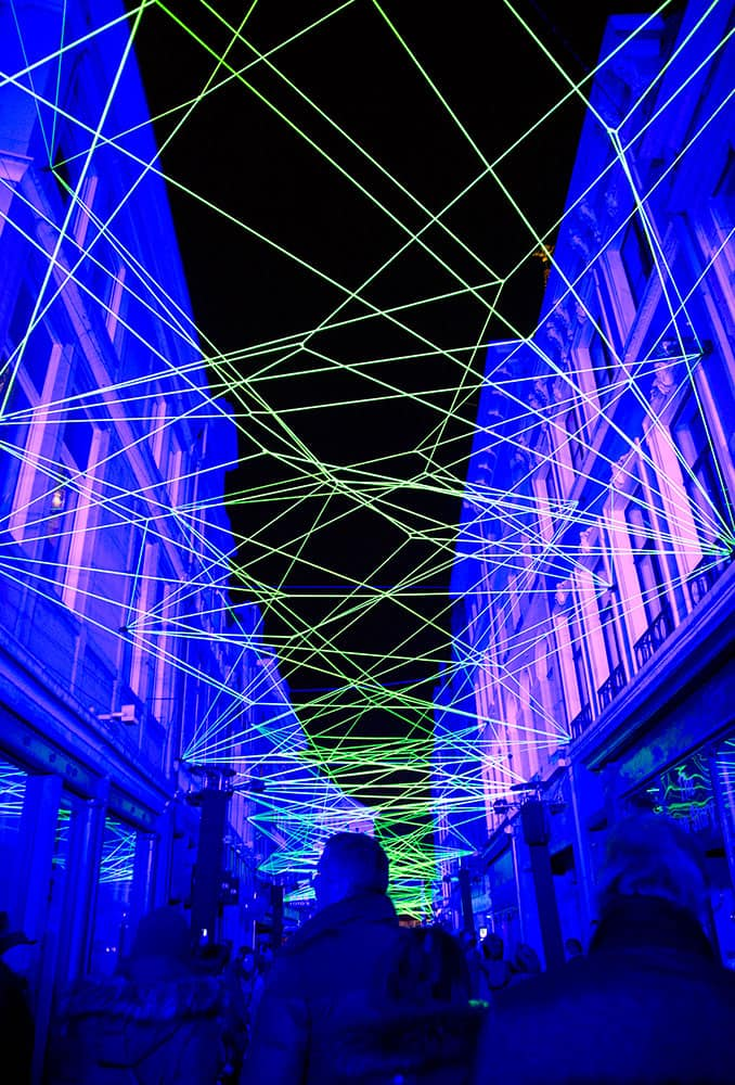 Visitors walk down an alley with a light projection during the light festival in Ghent, Belgium. More than 40 light installations were on display during the festival, which takes places every three years.