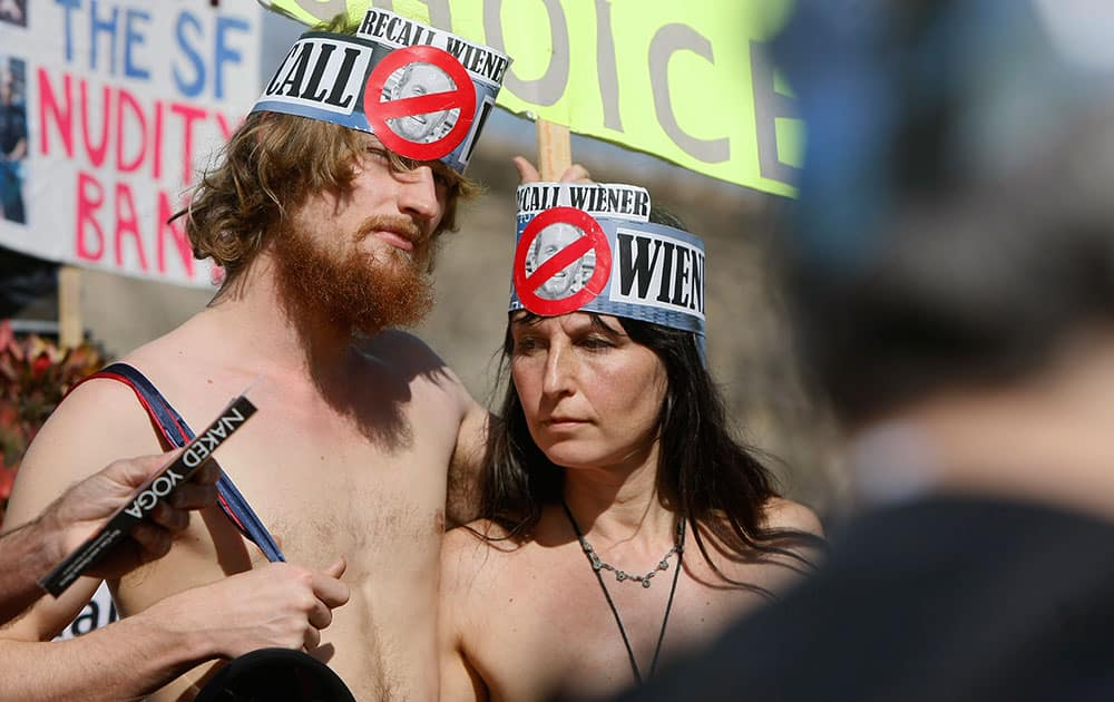 James Taub and Gypsy Taub stand in Jane Warner Plaza in the Castro District of San Francisco, Calif. during a protest against San Francisco's no-nudity law held on the ban's second anniversary. Three naked protesters where arrested by San Francisco police for violating the city's ban on public nudity.