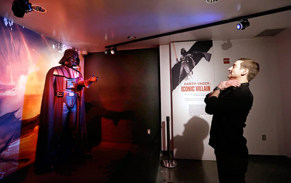 Project director Saul Drake stands-in where visitors are likely to want their photo taken in front of a Darth Vader costume on display as part of an exhibit on the costumes of Star Wars at Seattle's EMP Museum.