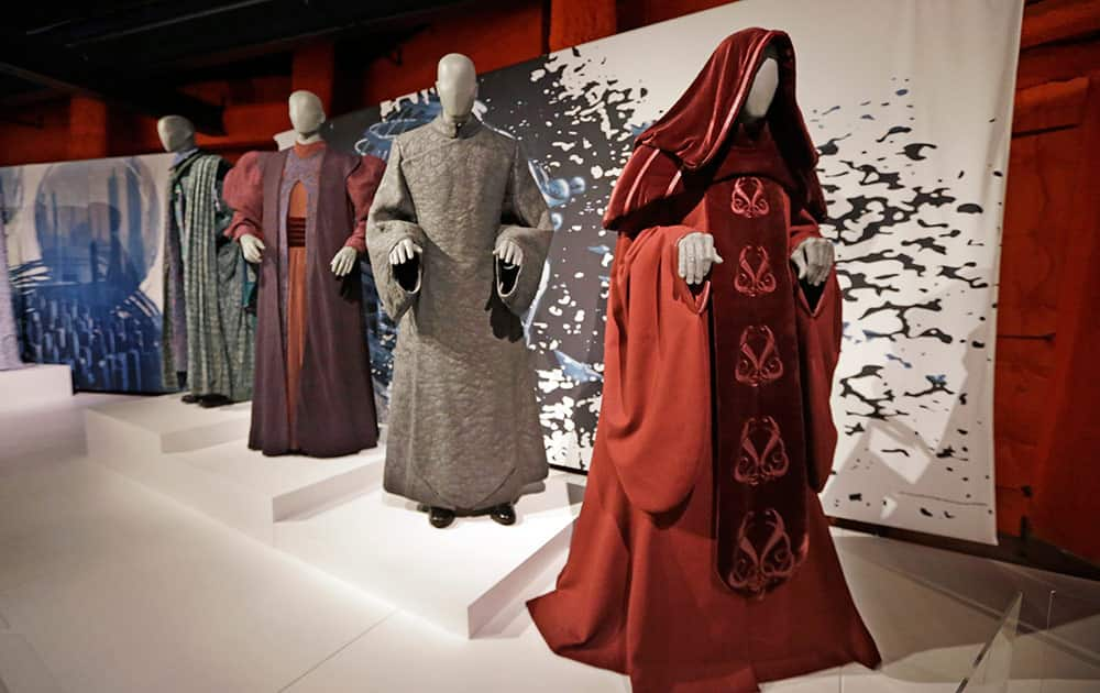 Senate and Trade Federation robes are displayed as part of an exhibit on the costumes of Star Wars at Seattle's EMP Museum.
