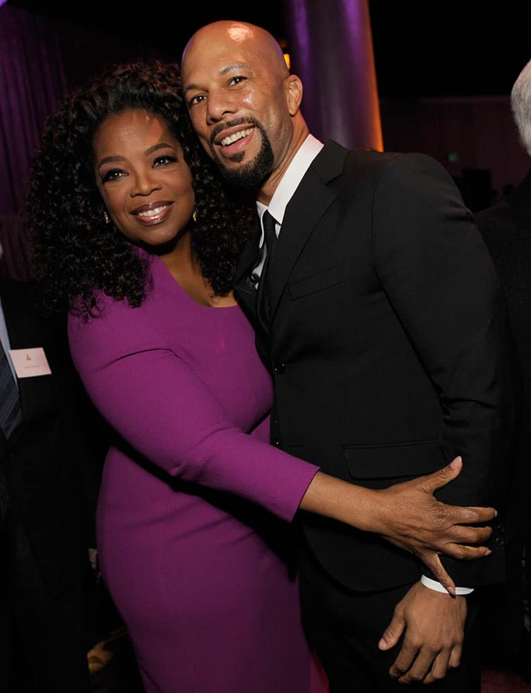 Oprah Winfrey, left, and Common attend the 87th Academy Awards nominees luncheon at the Beverly Hilton Hotel in Beverly Hills, Calif.