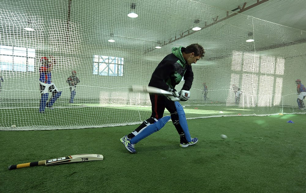 Afghan cricket player Nasir Ahmadzai practices at Kabul cricket academy training center, in Kabul, Afghanistan.