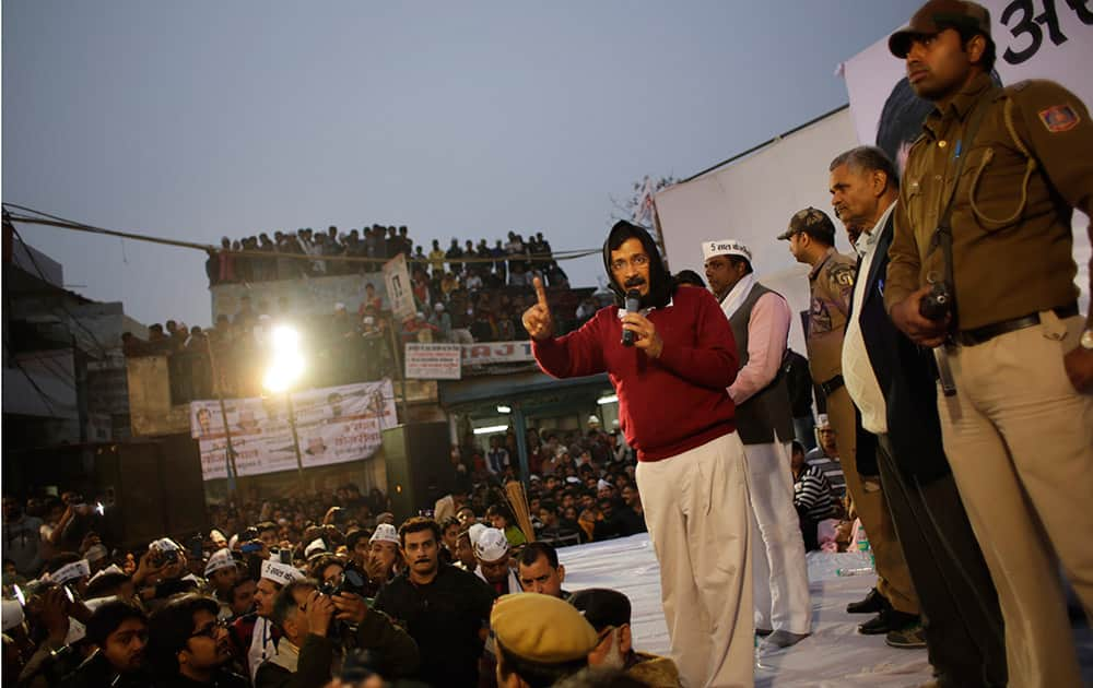 Aam Aadmi Party leader Arvind Kejriwal addresses an election rally in New Delhi.