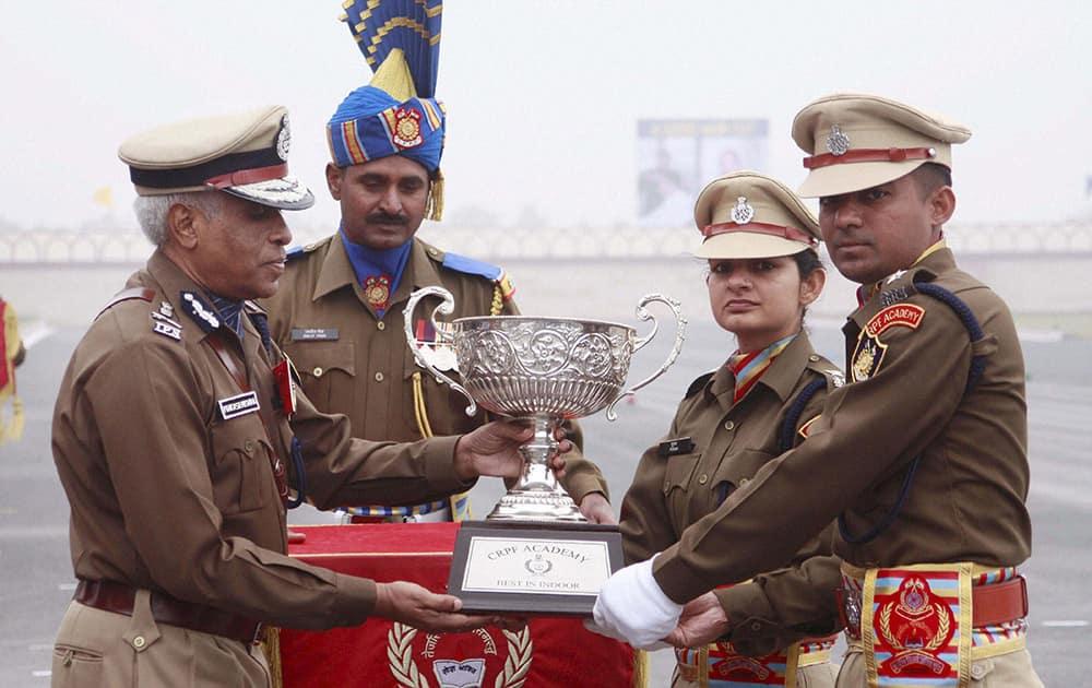CRPF DG Prakash Mishra awarding the Best trainees award to Pooja & Jagtap Vinayak Sadashiv during a passing out parade at CRPF Academy Kadarpur in Gurgaon.