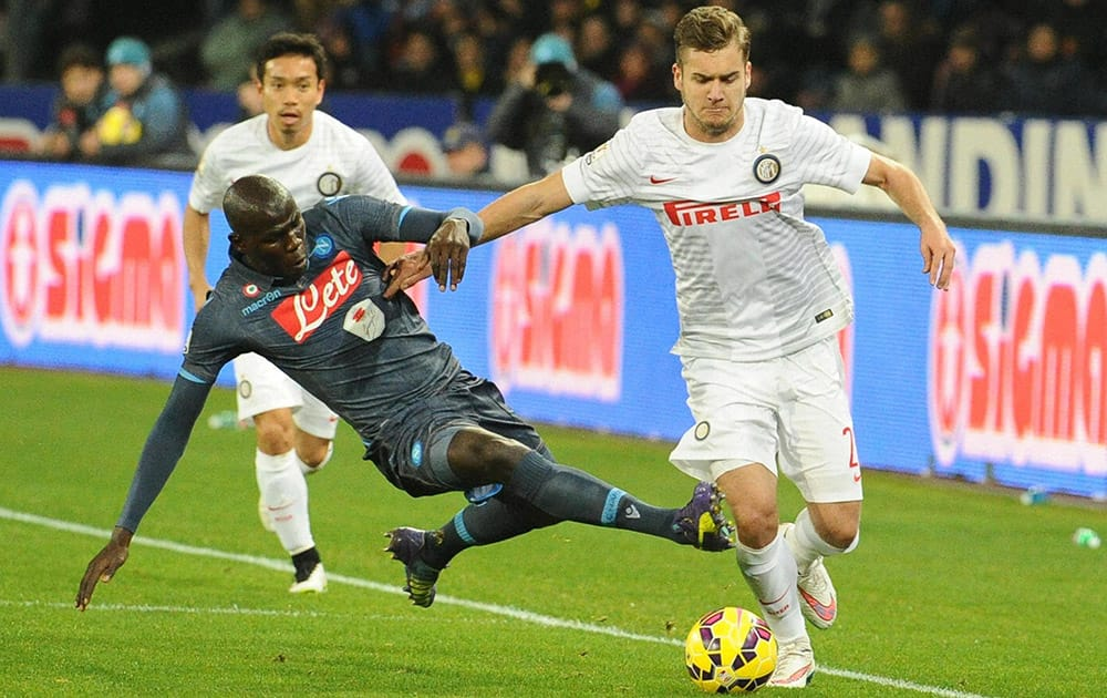Napolis Kalidou Koulibaly and Inter of Milans George Puscas vie for the ball during their Italian Cup quarter final soccer match in Naples, Italy.
