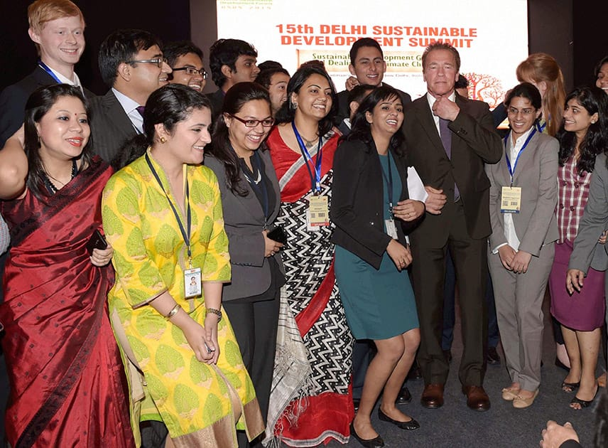 Actor and former Governor of California Arnold Schwarzenegger with students during the 15th Delhi Sustainable Development Summit in New Delhi.