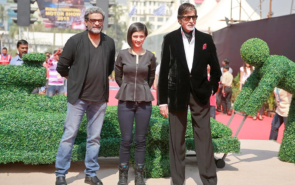 Bollywood superstar Amitabh Bachchan, poses with co-star Akshara Haasan and director R. Balakrishnan at an event to promote his film 'Shamitabh' in the sidelines of a motor show in Mumbai.